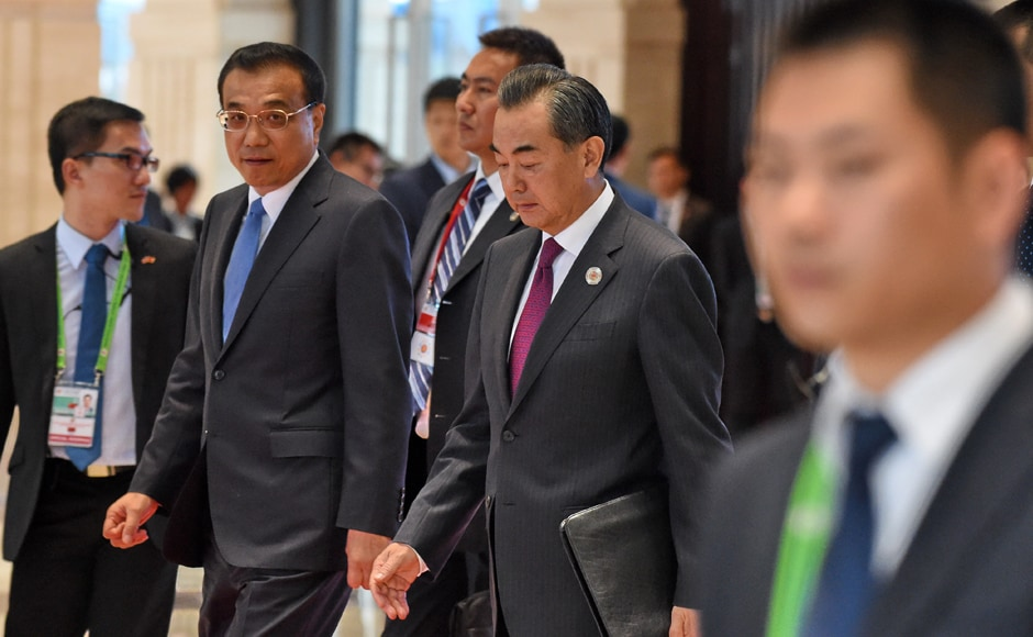 Chinese Premier Li Keqiang (2nd L) walks with Foreign Minister Wang Yi (2nd R) after a meeting session at the Association of Southeast Asian Nations (ASEAN) Summit in Vientiane. The gathering will see the 10 ASEAN members meet by themselves, then with leaders from the US, Japan, South Korea and China. AFP