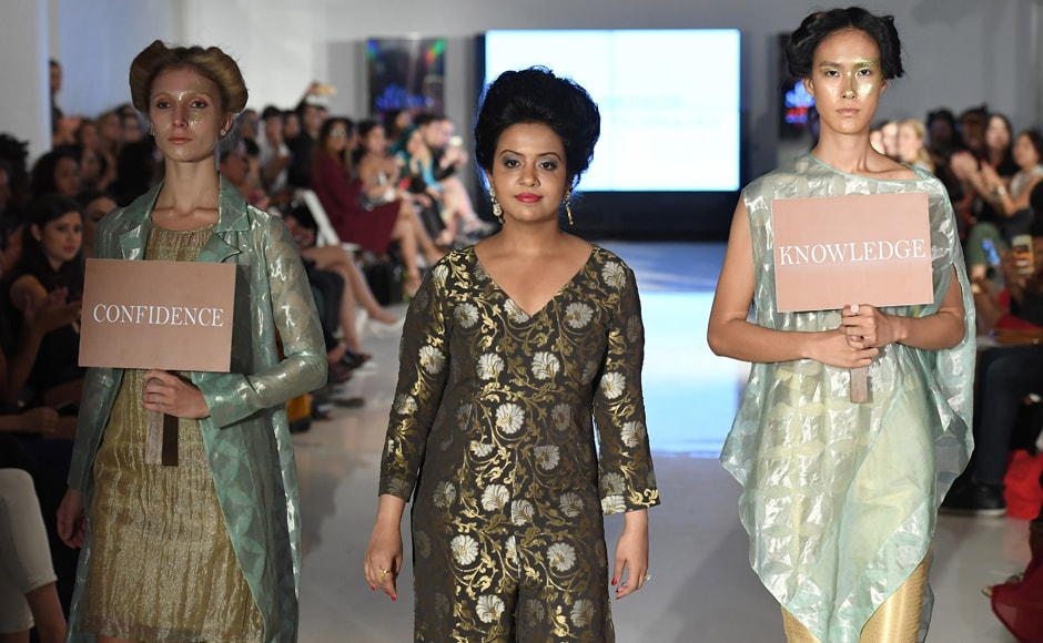 Amruta Fadnavis walks the runway with models during the Chasa IDT at the New York Fashion Week at Space 404. AFP