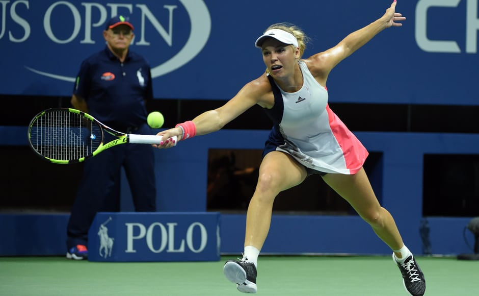 Caroline Wozniacki of Denmark hits a return against Angelique Kerber of Germany. AFP