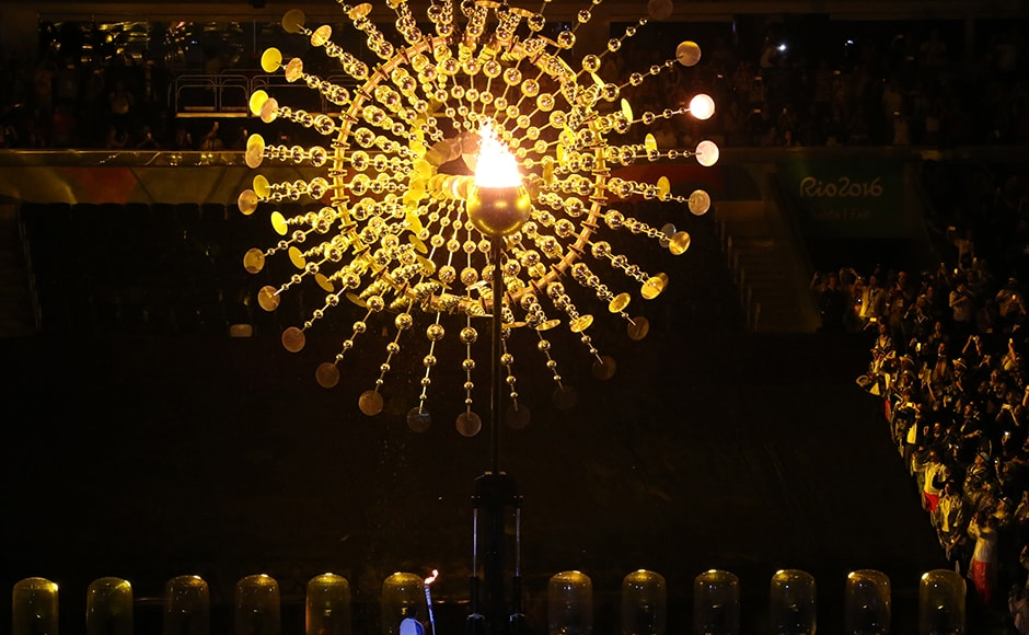 Brazilian Paralympic swimmer Clodoaldo Silva lights the flame during the opening ceremony. Reuters