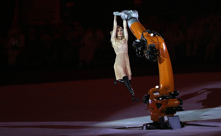 A performer interacts with a robotic arm during the opening ceremony of Rio Paralympics. Reuters