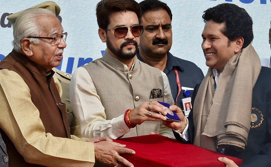 Uttar Pradesh Governor Ram Naik and BCCI President Anurag Thakur present momentos to former Indian Cricket captain Sachin Tendulkar on the occasion of India's 500th Test match at Green Park in Kanpur on Thursday. PTI Photo by Atul Yadav (PTI9_22_2016_000035B)