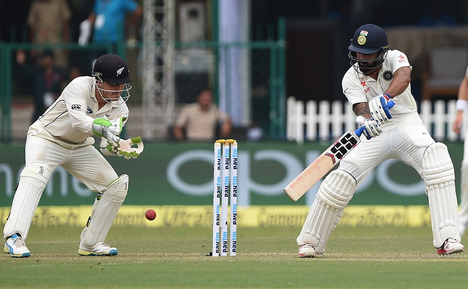 Murali Vijay plays a shot as New Zealand wicket keeper BJ Watling looks on. AFP