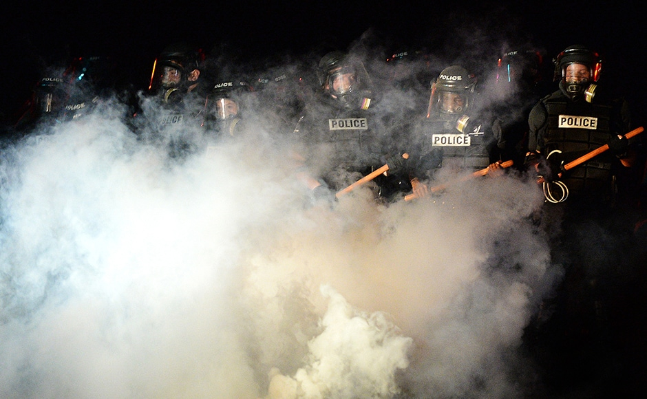 Police stand in formation in Charlotte. Authorities used tear gas to disperse protesters in an overnight demonstration that broke out Tuesday after Keith Lamont Scott was fatally shot by an officer at an apartment complex. AP