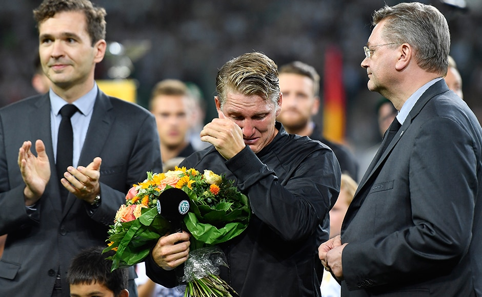 Bastian Schweinsteiger who captained 2014 World Cup winners Germany hides his tears before playing in his match for the Die Mannschaft. AP