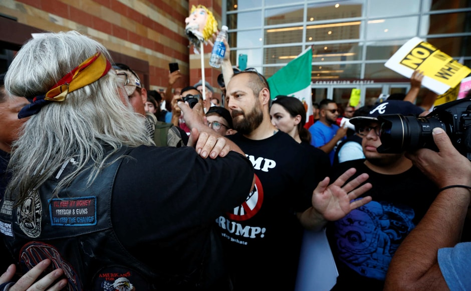 Trump asserted that Mexico would indeed pay for a border wall between Mexico and US. People in Arizona fought amongst themselves even as they all protested against Trump. Photo: Reuters