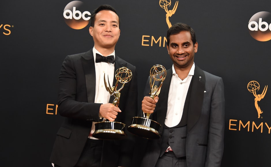 Aziz Ansari, right, and Kelvin Yu winners of the award for outstanding writing for a comedy series for 'Master of None' pose in the press room at the 68th Primetime Emmy Awards on Sunday, Sept. 18, 2016, at the Microsoft Theater in Los Angeles. (Photo by Jordan Strauss/Invision/AP)