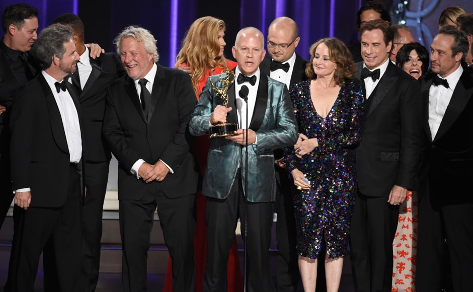 Ryan Murphy and the cast and crew of 'The People v. O.J. Simpson: American Crime Story' accept the award for outstanding limited series at the 68th Primetime Emmy Awards on Sunday, Sept. 18, 2016, at the Microsoft Theater in Los Angeles. (Photo by Chris Pizzello/Invision/AP)