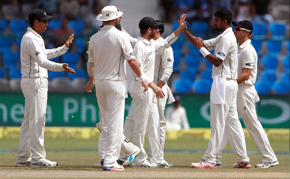 New Zealand's Ish Sodhi, and his team celebrates the wicket of India's Cheteshwar Pujara. AP