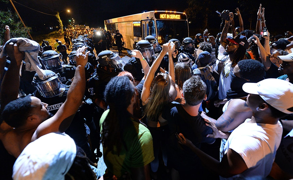 Early Wednesday morning, protesters blocked Interstate 85, where they stole boxes from trucks and started fires before police used flash grenades in an attempt to disperse the angry crowd, an ABC affiliate in Charlotte reported. AP
