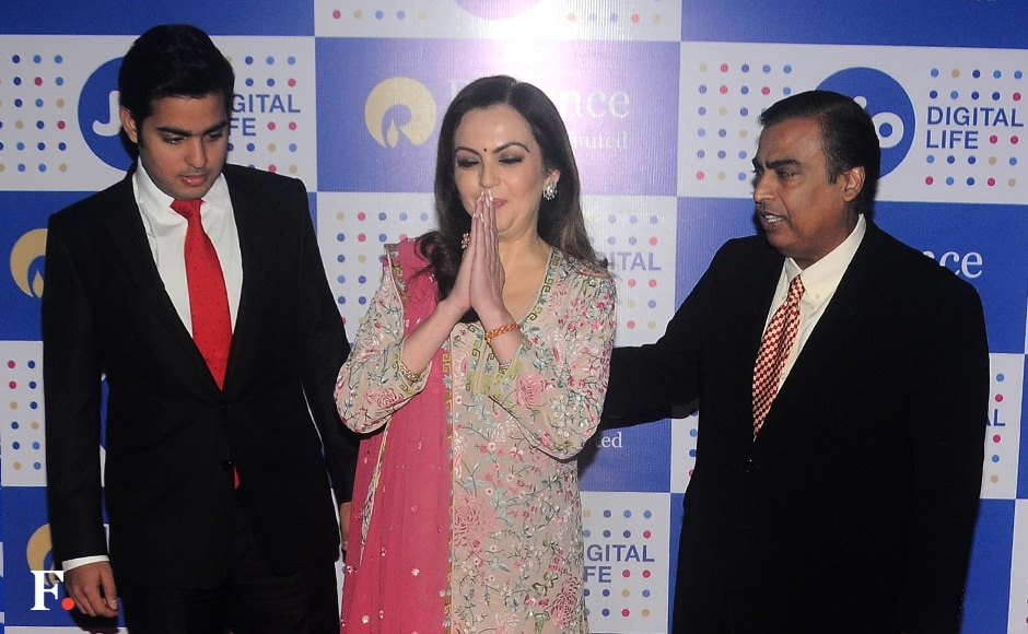 Mukesh Ambani with his wife Nita Ambani and son Akash Ambani posed for the press after the event. Ambani termed the Jio introductory offer as the largest anywhere in the world, stating that the company is offering free data, voice and video