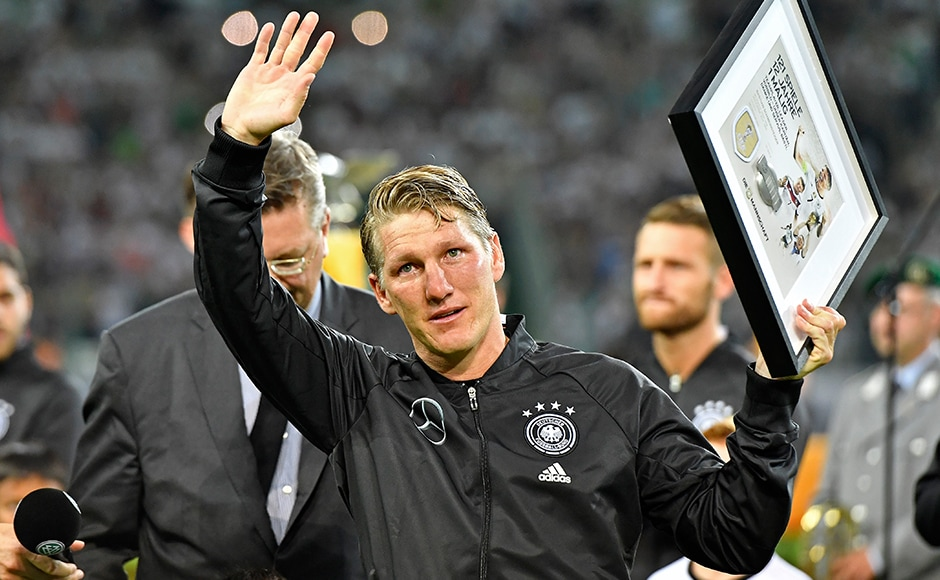 Germany's Bastian Schweinsteiger waves to supporters during a farewell ceremony prior a friendly football match between Germany and Finland. AP