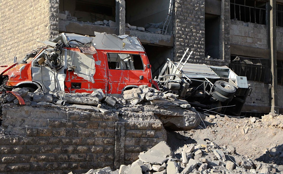 Air strikes in Syria's Aleppo city wounded dozens of people and an unknown number remains buried. A member of the Syrian civil defense said that some of their vehicles were also destroyed. Ambulances were also destroyed in the air strikes. Photo: AP