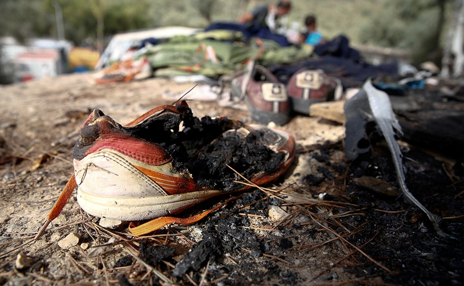 A burned shoe is seen on the ground. The United Nations refugee agency, UNHCR, linked the fire to poor living conditions and a sense of insecurity among many of the residents. Reuters