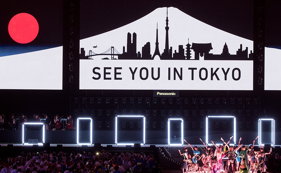 "In this photo released by the IOC, Koichi Omae and four female dancers are joined on stage by GIMICO, Aya Sato, Bambi and Akira Hiyama as a sign saying ""see you in Tokyo"" appears behind the performers during the closing ceremony of the Rio 2016 Paralympic Games at the Maracan' Stadium in Rio de Janeiro, Brazil , Sunday, Sept. 18, 2016. (Simon Bruty/OIS, IOC via AP)"