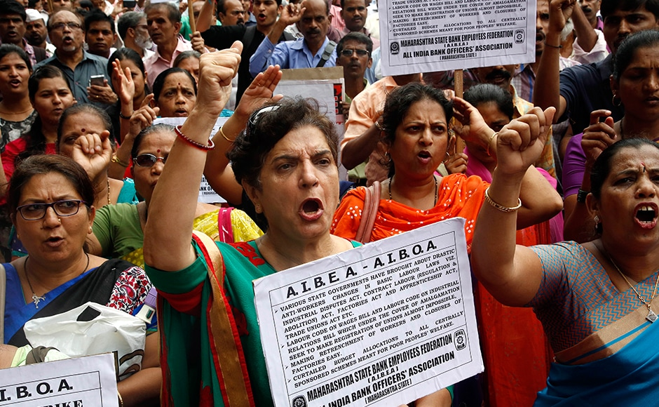 Indian government and bank employees shout slogans as they participates in a protest during a nationwide strike called by trade unions in Mumbai. The strike howveer evoked a mixed response in Maharashtra. AP