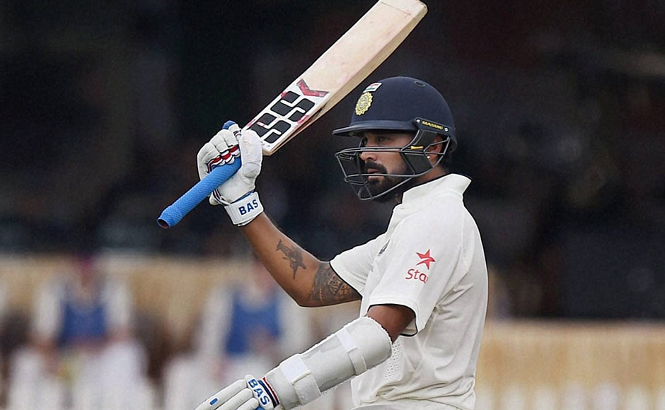 Indian batsman Murali Vijay raises his bat after completing a half-century. PTI