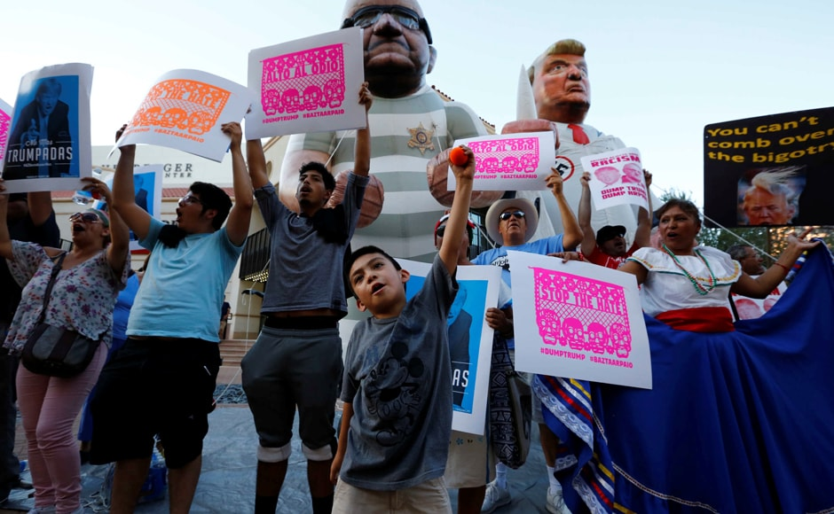 In phoenix, Trump called many illegal migrants 'murderers. Protesters rallied against Trump's visit. Photo: Reuters