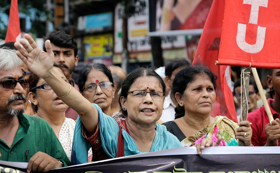 Activists of Communist Party of India-Marxist shout slogans during the nationwide strike, in Kolkata on Friday. Major roads wore a deserted look in the state capital and as public transport was not available, passengers, particularly alighting from trains, had a harrowing time reaching their destination.