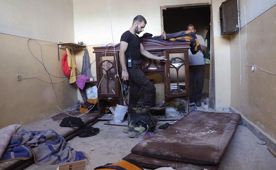 The air strikes come as Syria's military command announced it is launching operations in Aleppo's rebel-held eastern quarters. Rescue workers checked the damage inside the Syrian Civil Defense main center after the air strikes. Photo: AP