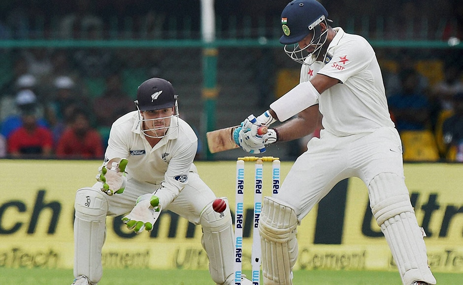 Indian batsman Cheteshwar Pujara plays a shot on the opening day of the first Test match. PTI