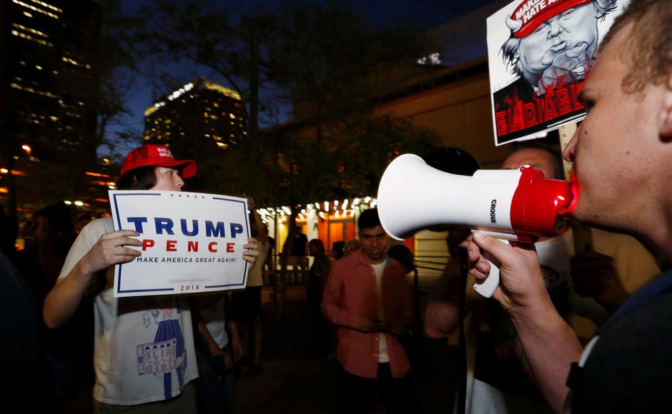 Protesters rallying against Trump's stance on immigrants and his trip to Mexico had a face off with his supporters outside the Phoenix Convention Center Phoenix, Arizona. Photo: Reuters