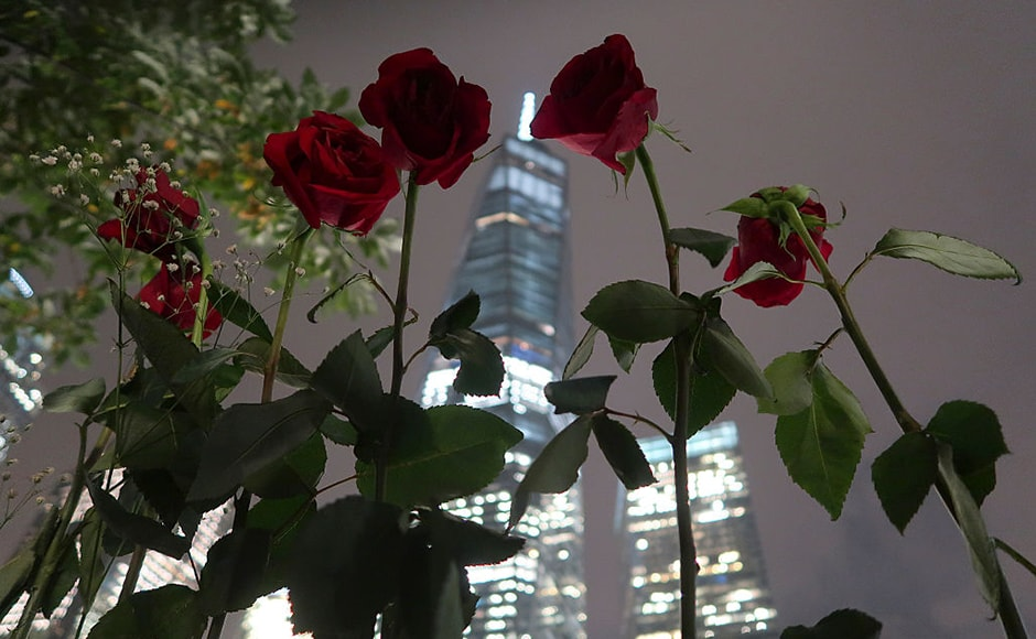Roses are left in front of One World Trade Center at the national 9/11 Memorial in advance of the 15th anniversary of the 9/11 attacks. Getty Images