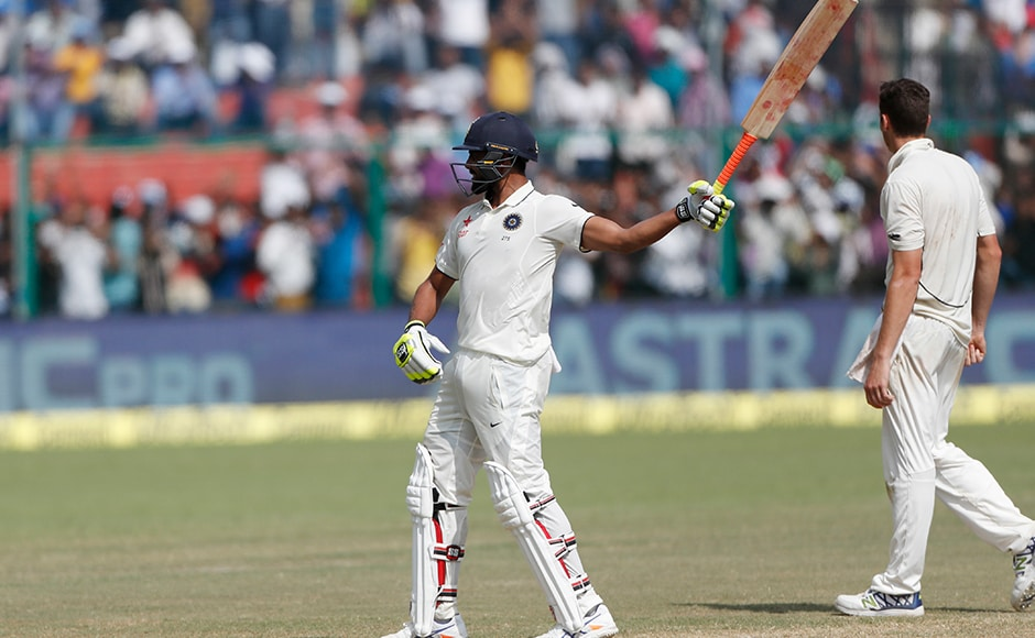 India's Ravindra Jadeja waves his bat like a sword in celebration after scoring his fifty. Virat Kohli declared the innings as soon as he got to the milestone. New Zealand were asked to chase a target of 434 runs. AP