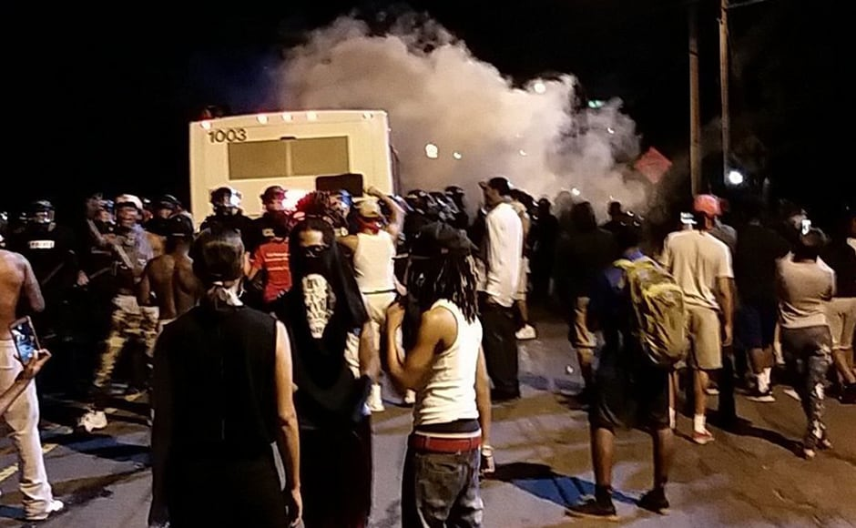 Police fire tear gas into the crowd of protesters on Old Concord Road late Tuesday night in Charlotte. AP