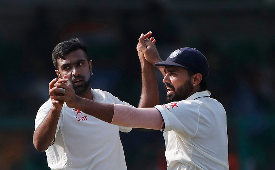 India's Ravichandran Ashwin and  Murali Vijay celebrate the wicket of New Zealand's Kane Williamson which incidentally was also his 200th scalp. He is the second fastest to reach the milestone. AP