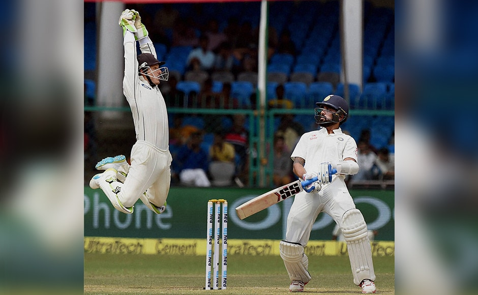 Murali Vijay reacts after facing a delivery during the first day. PTI