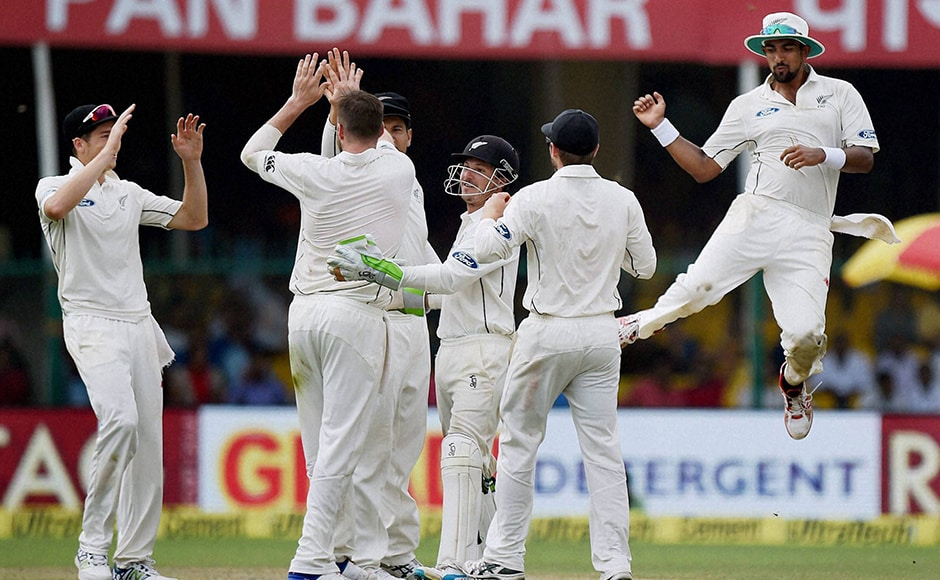 New Zealand players celebrating the wicket of Ajinkya Rahane during the first day of first test match at Green Park in Kanpur on Thursday. PTI(PTI9_22_2016_000115B)