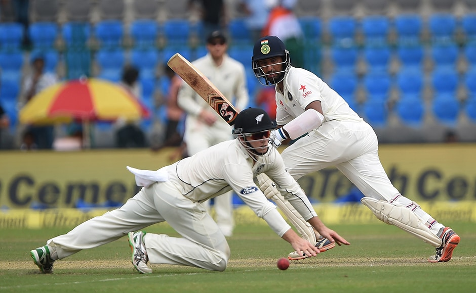 New Zealand's Tom Latham makes an unsuccessfull attempt to stop a shot by Cheteshwar Pujara. AFP