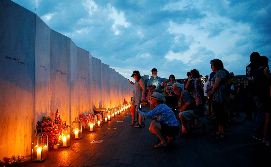 Candles in memory of the passengers and crew of Flight 93, are lit along the Wall of Names at the Flight 93 National Memorial in Shanksville, Pennsylvania. AP