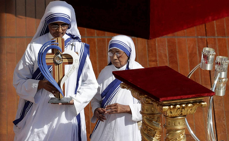 Sisters of the Missionaries of Charity pay their respects in front of the relics of Mother Teresa during her Canonization Mass. The Missionaries of Charity was a Roman Catholic religious congregation established in 1950 by Mother Teresa. AP