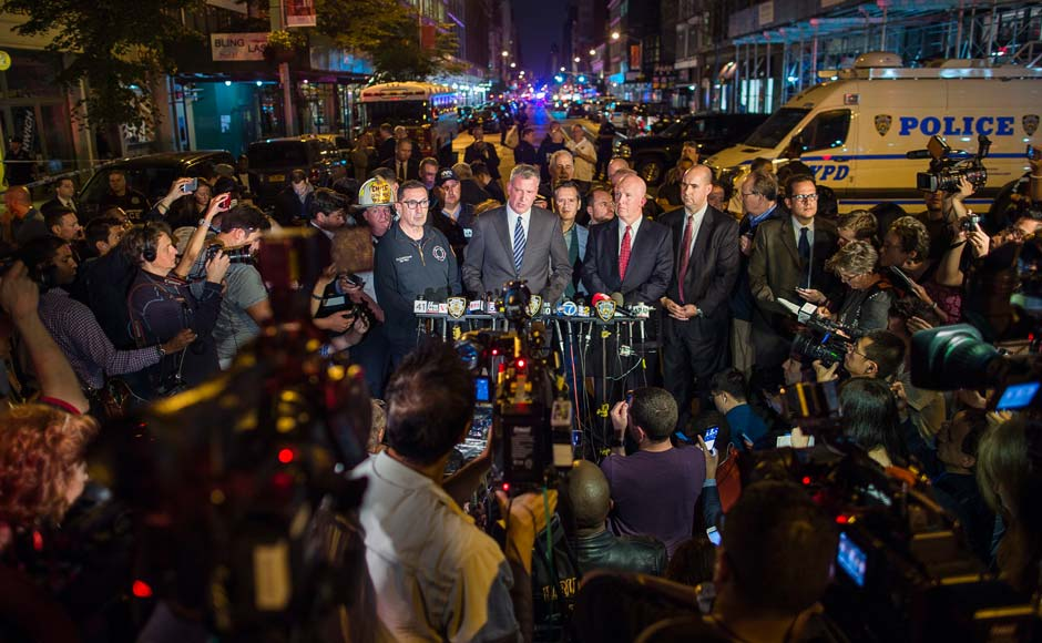 Mayor Bill de Blasio, center, and NYPD Chief of Department James O'Neill, center right, speak during a press conference near the scene of an apparent explosion on West 23rd street in Manhattan's Chelsea neighborhood. AP