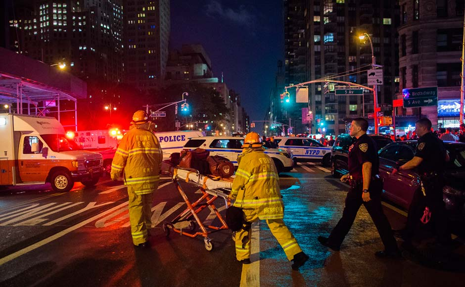 Police and firefighters work near the scene of an apparent explosion in Manhattan's Chelsea neighborhood, in New York. More than two dozen people sustained minor injuries in the explosion on West 23rd Street. AP