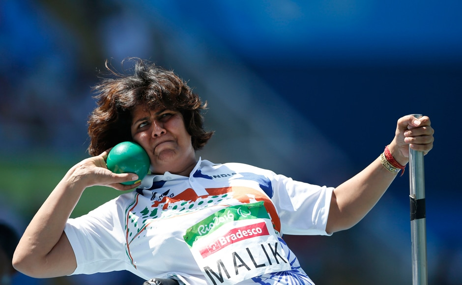 India's Deepa Malik competes in the women's final shot put F53 athletics event during the Paralympic Games. AP