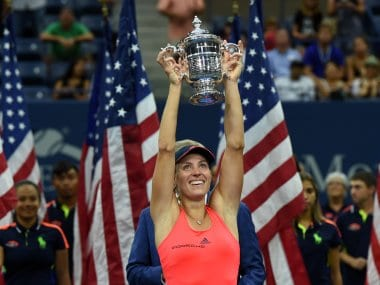 Angelique Kerber holds up the US Open trophy after defeating Karolina Pliskova. AFP
