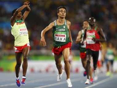 Abdellatif Baka of Algeria wins the gold medal in the 1500m T13 event. Reuters