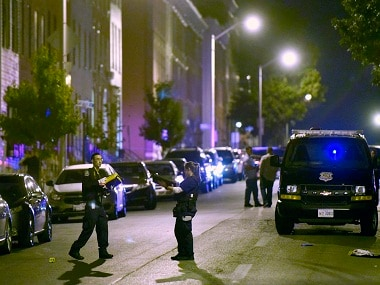 Baltimore police work at a scene where multiple people were shot in Baltimore, Saturday, Sept. 24, 2016. Police said that none of the shootings were fatal. (AP Photo/Steve Ruark)