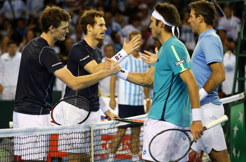 Great Britain's Andy and Jamie Murray shake hands with Argentina's Juan Martin del Potro and Leonardo Mayer after winning their doubles match. AP