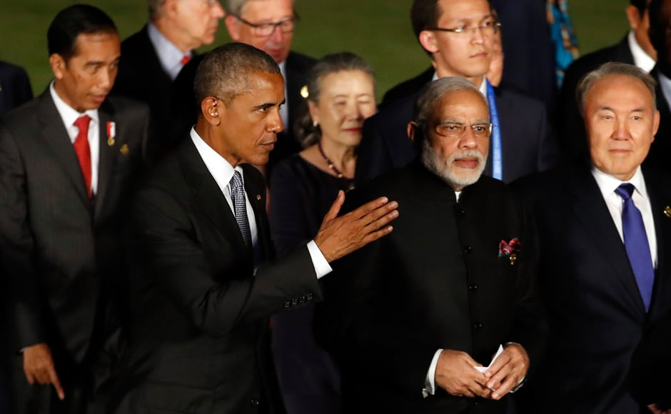 U.S. President Barack Obama walks with Indian Prime Minister Narendra Modi after a group photo session for the G-20 Summit at Xizi Hotel in Hangzhou in eastern China's Zhejiang province. AP