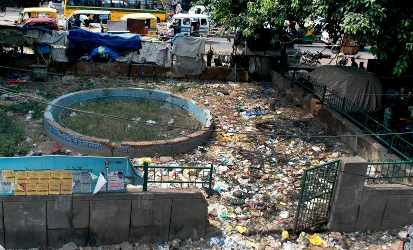A bird's eye view of a community park at a local market in Govindpuri, South East Delhi, which has long been turned into a garbage dumping site. (Photos: Debobrat Ghose and Naresh Sharma )