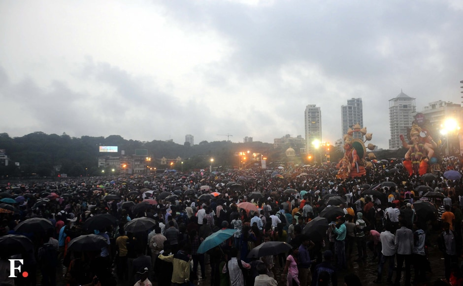 Clouds gathered on the morning of the final day of Visarjan. Various people gathered on the beachs of Mumbai with umbrellas in hand to say their farewell to Lord Ganesha. Sachin Gokhale/Firstpost