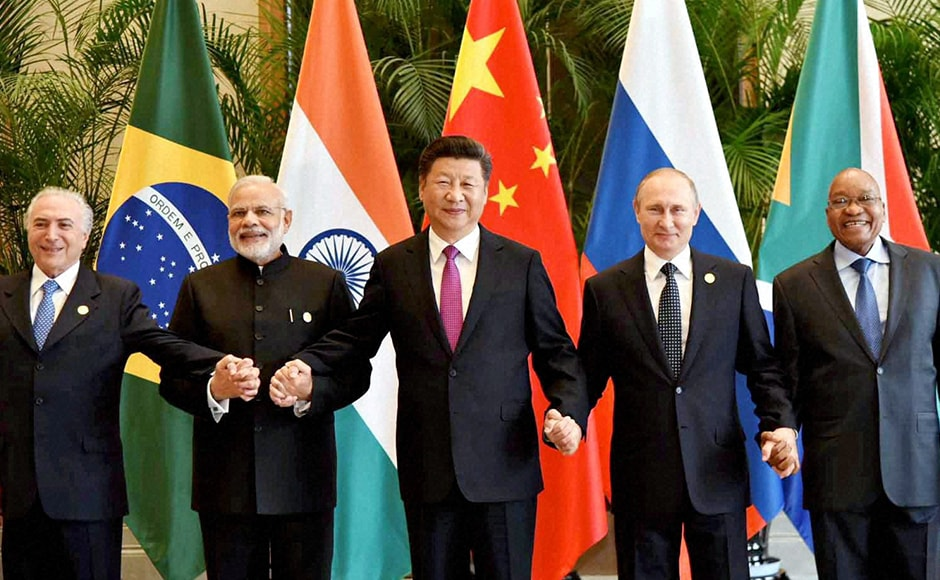 Brazilian President Michel Temer , Russian President Vladimir Putin, Prime Minister Narendra Modi, Chinese President Xi Jinping and South African President Jacob Zuma held an informal meeting to reaffirm their loose alliance known as the BRICS group of emerging market powerhouses. PTI