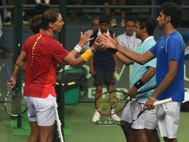 Spain's Rafael Nadal and Marc Lopez with India's Leander Paes and Saketh Myeni after wining the Davis Cup match. AP