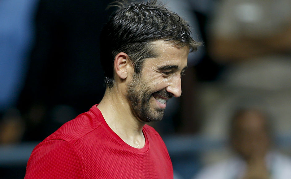 Spain's Marc Lopez reacts after he won the match in his Davis Cup men's tie against India's Sumit Nagal in New Delhi, India, Sunday, Sept. 18, 2016. (AP Photo /Tsering Topgyal)