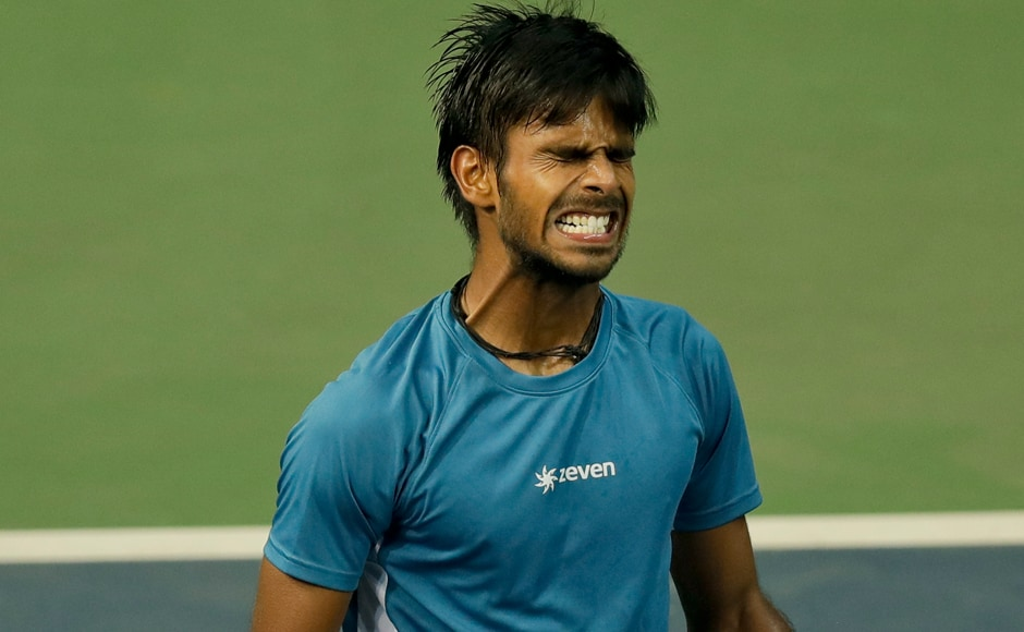 India's Sumit Nagal reacts during his Davis Cup men's tie against Spain's Marc Lopez as he lost the match 3-6, 6-1, 3-6 . AP