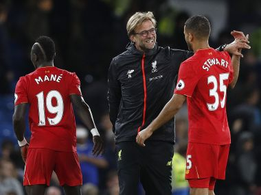 Liverpool manager Jurgen Klopp celebrates with his players after his side's 2-1 win over Chelsea in the Premier League. AFP